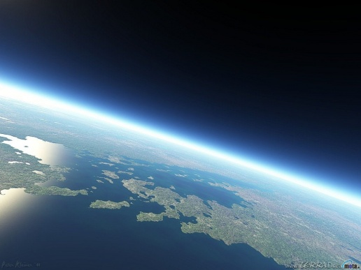 Phillips Space Systems Main Page image-edge view of Earth with sunrise ahead of FOV